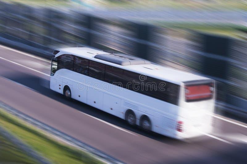 Tour Bus running, motion blur royalty free stock image