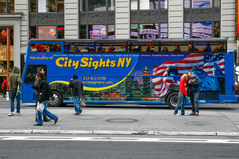 Tour Bus in Times Square New York City. A sightseeing tour bus waits in traffic in the Times Square area in mid-town Mahattan near the Broadway Theater District stock images