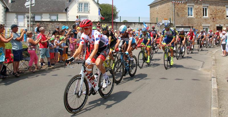 Tour de France cyclists with TOMS SKUJINS in the red polka dot jersey 2018 royalty free stock photos