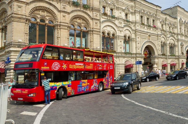 Tour double-Decker bus `City Sihgtseeng` in Moscow, Russia. Moscow, Russia - July 27, 2016: Tour double-Decker bus `City Sihgtseeng` on Ilyinka street near the stock images
