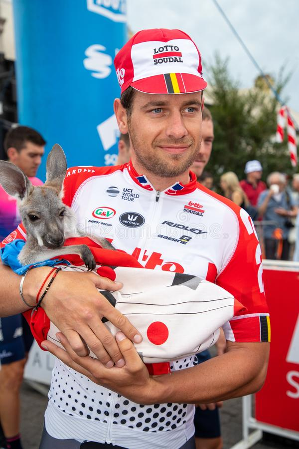 Tour Down Under 2019. ADELAIDE, AUSTRALIA - JANUARY 18 2019. Adam Blythe of UK and Lotto-Soudal holding a baby Kangaroo before the start of Stage 4 from Unley to stock image