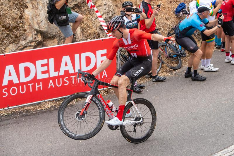 Tour Down Under 2019. ADELAIDE, AUSTRALIA - JANUARY 18 2019. Cees Bol of Netherlands and Team Sunweb doing a wheelie entertaining with the large crowd on the stock photography