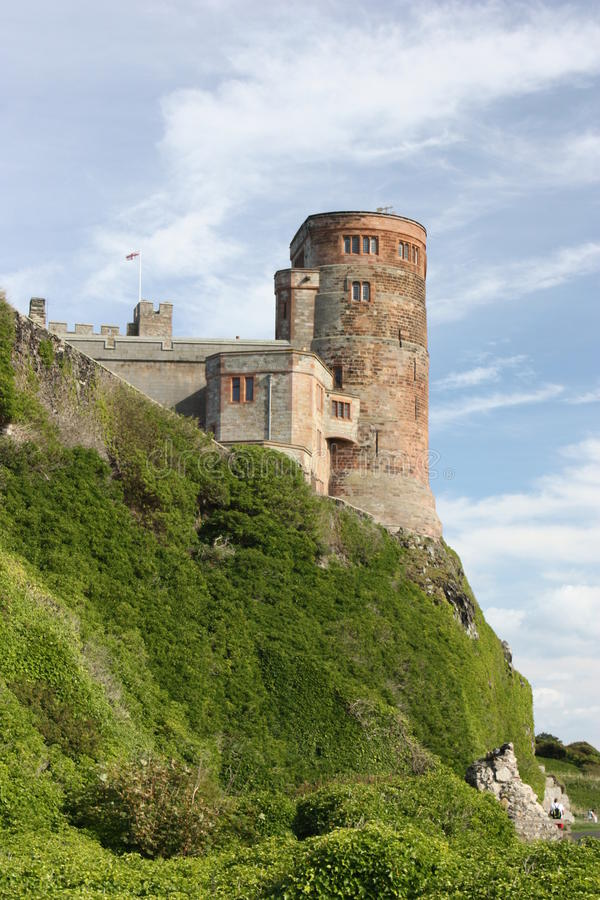 Tour du sud-est de château de Bamburgh photos stock