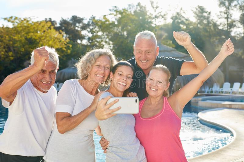 Tour group makes selfie with tour guide royalty free stock images