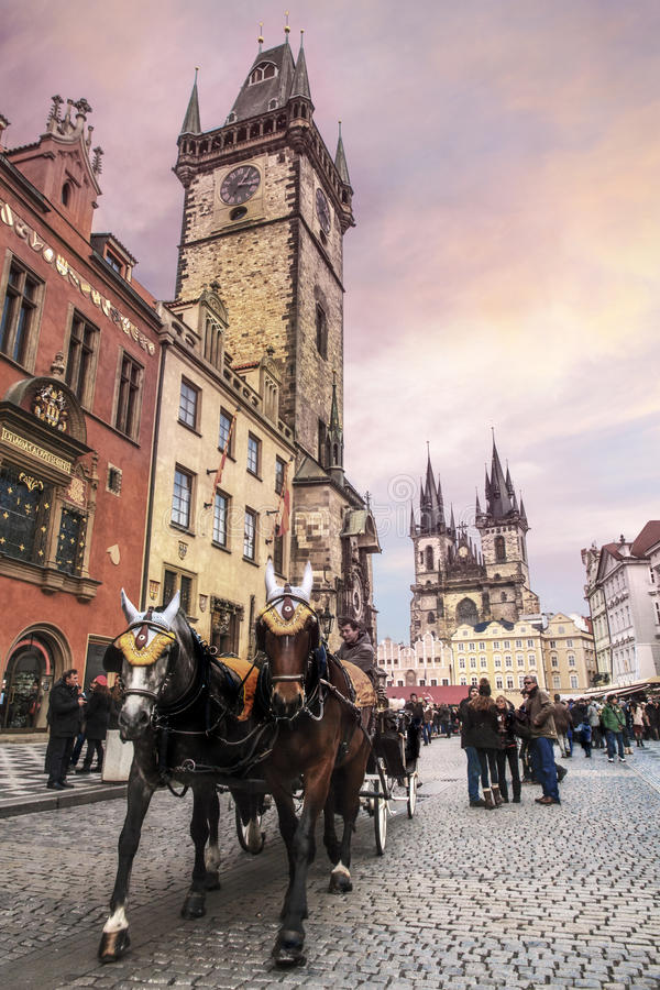 Tour guide job at Prague. Tour guide bringing tourist on a horse carriage visiting by the old town hall of Prague, Czech Republic stock photography