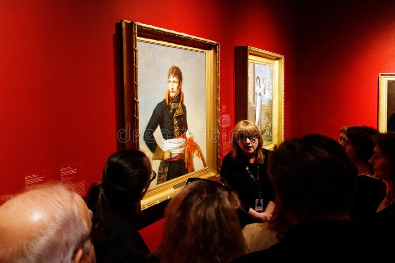 A tour guide in a museum stock image
