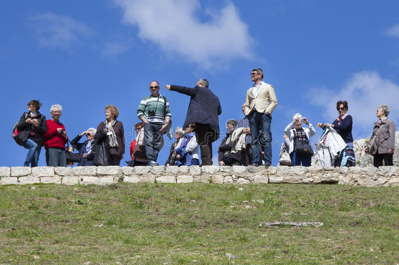 Tour guide pointing. Greek theater, Syracuse. Italy royalty free stock photo
