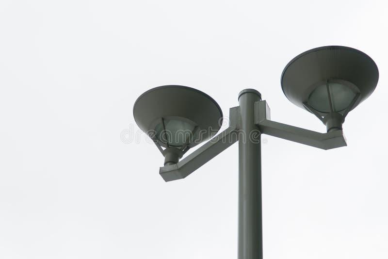 Tour légère et lampe noire avec le fond blanc lumineux image stock