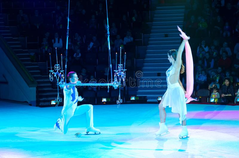 Tour of Moscow Circus on Ice. Adagio aerial gymnasts on matte trapeze stock images