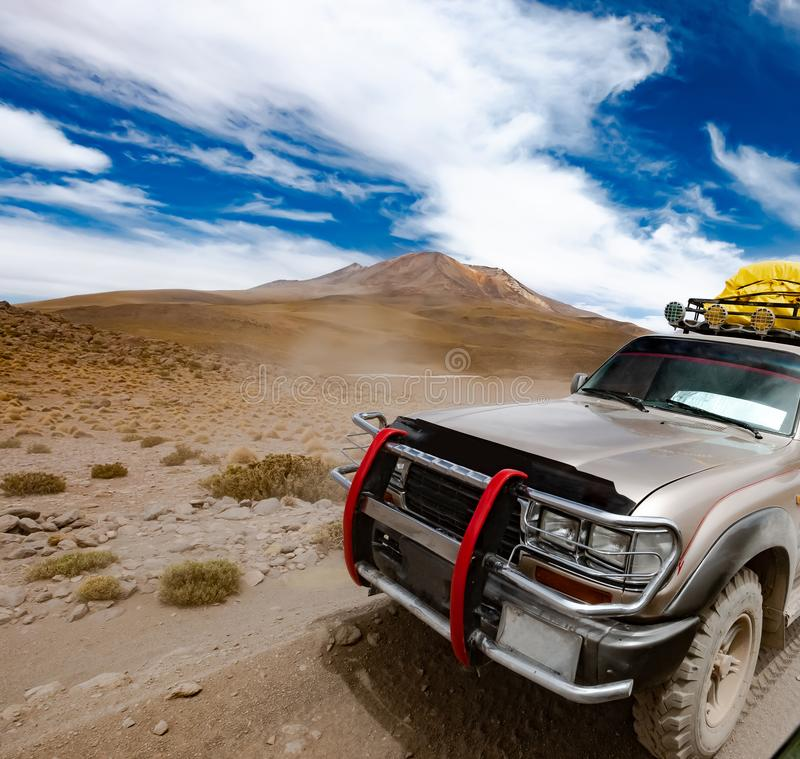 Tour offroad car in Bolivian desert. Tour offroad car on background of sunshine Bolivian desert stock photos