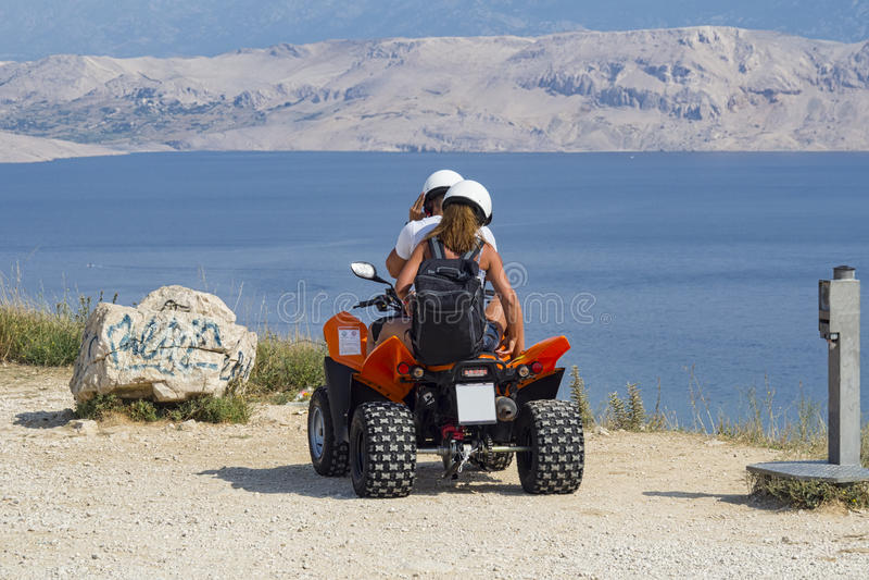 Quad tour. Tour in quad on the seaside royalty free stock photo