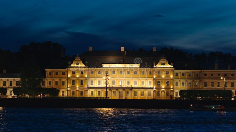 Tour ship swims past the Menshikov Palace in the White Nights. ST. PETERSBURG, RUSSIA - JUNE 18, 2017: Tour ship swims past the Menshikov Palace in the White stock images