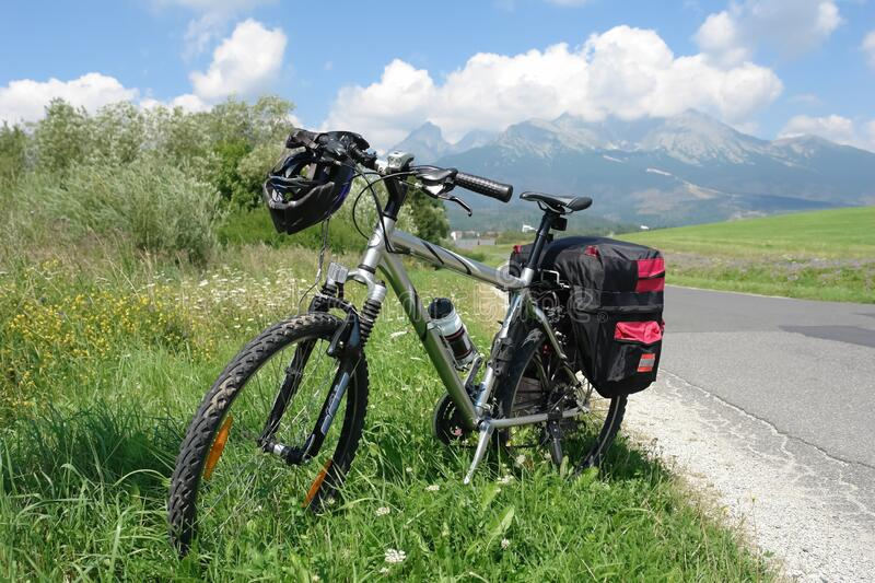 Touring bike and road in the High Tatras, Slovakia royalty free stock photos