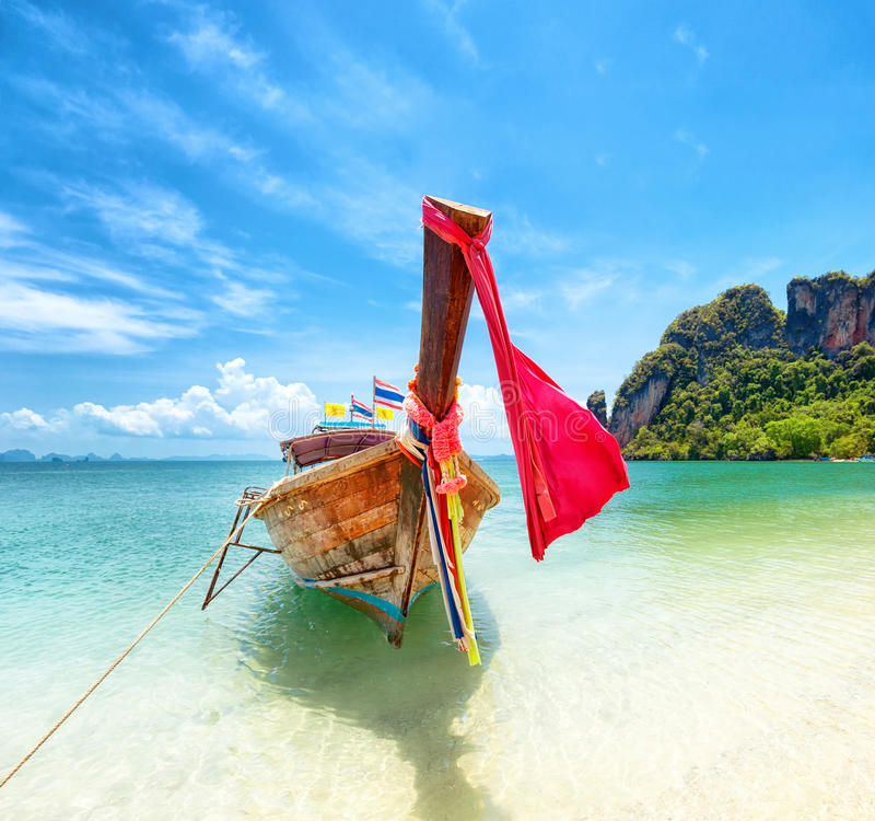 Tourism in Asia. Tropical island and tourist boat on exotic beach. Tourism in Asia. Tropical island and tourist boat on exotic sandy beach in Thailand. Travel royalty free stock photos