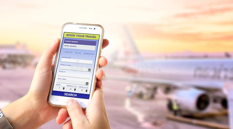 Tourism booking user interface on the screen of cell phone. Tourism booking user interface. Young Girl in the airport with a phone in her hands and app or web royalty free stock image