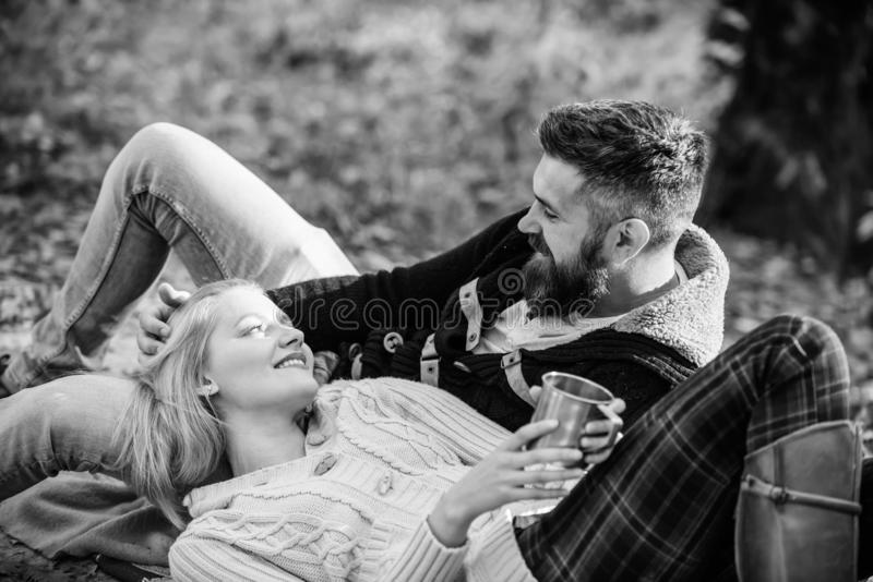 Tourism concept. Picnic time. Happy loving couple relaxing in park together. Romantic picnic forest. Couple in love stock images