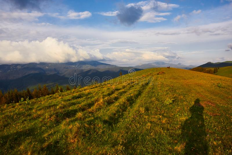 Tourism day, travel. beautiful landscape of the mountains with clouds on the sky stock photography
