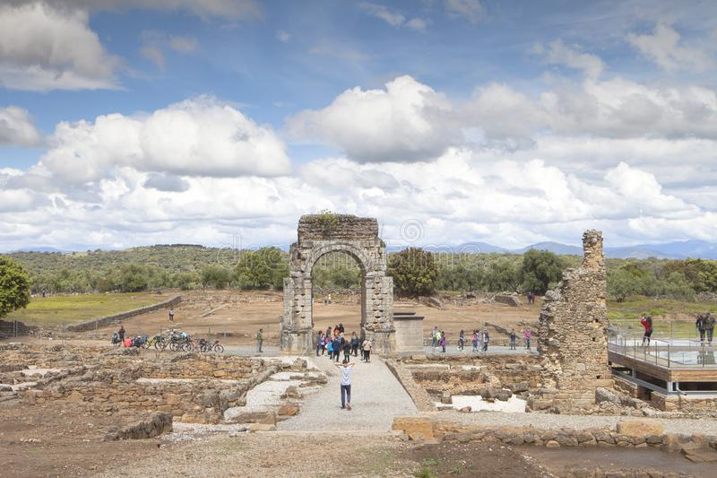 Tourism in Extremadura, Spain. Cáparra, Cáceres Province, Extremadura region, Spain: April 18, 2019: Tourists visiting the Roman villa.  Group of cyclists stock image
