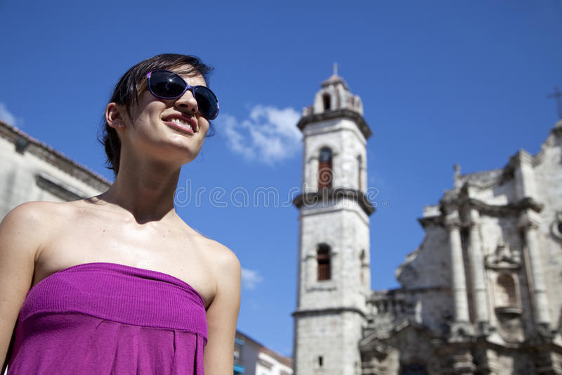 Tourism: happy woman smiling in Havana, Cuba stock photography