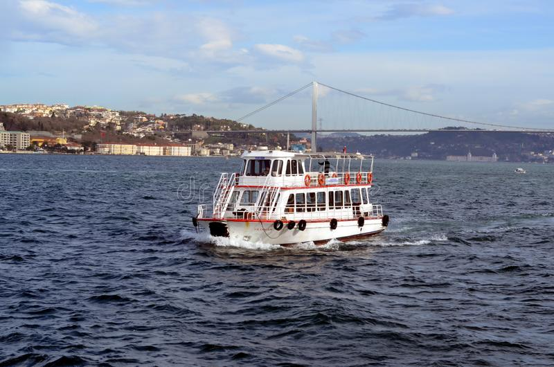 Tourism in Istanbul. ISTANBUL, TURKEY - JAN 19, 2013 - Passenger ferry on Bosphorus in Istanbul, Turkey royalty free stock images