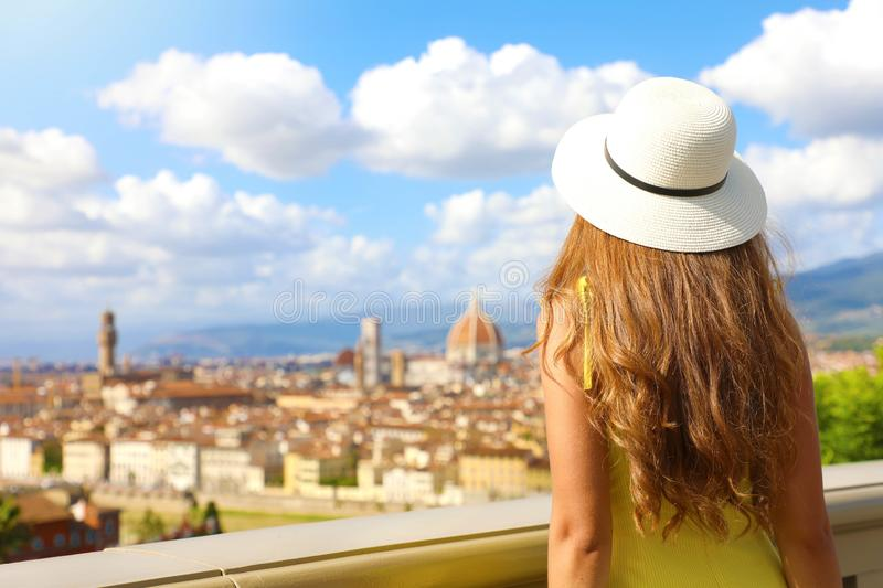 Tourism in Italy. Back view of young woman enjoying panoramic view of Florence city, Tuscany, Italy royalty free stock images