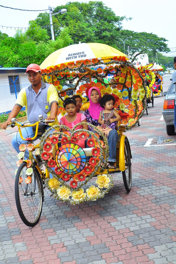 Tourism Malaysia - trishaw and passenger stock images