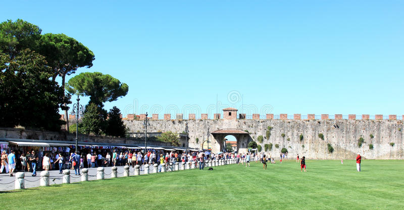 Tourism Near City Walls Of Pisa, Italy Editorial Image