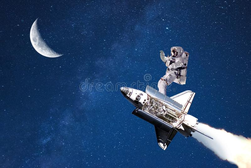 Tourism in outer space.spaceman flying on moon. stock images