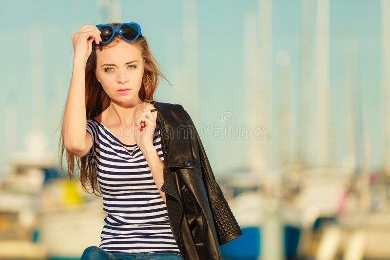 Woman in marina against yachts in port royalty free stock photo