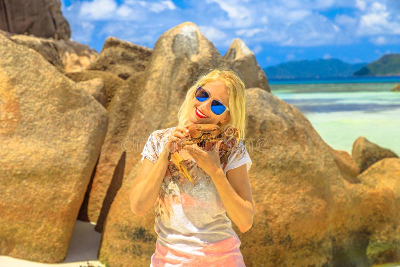 Woman with Ghost Crab. Tourism in Seychelles, Africa, Indian Ocean. Tourist woman holding an Ocypode Ceratophthalmus or Ghost Crab or Sand Crab with one claw stock images