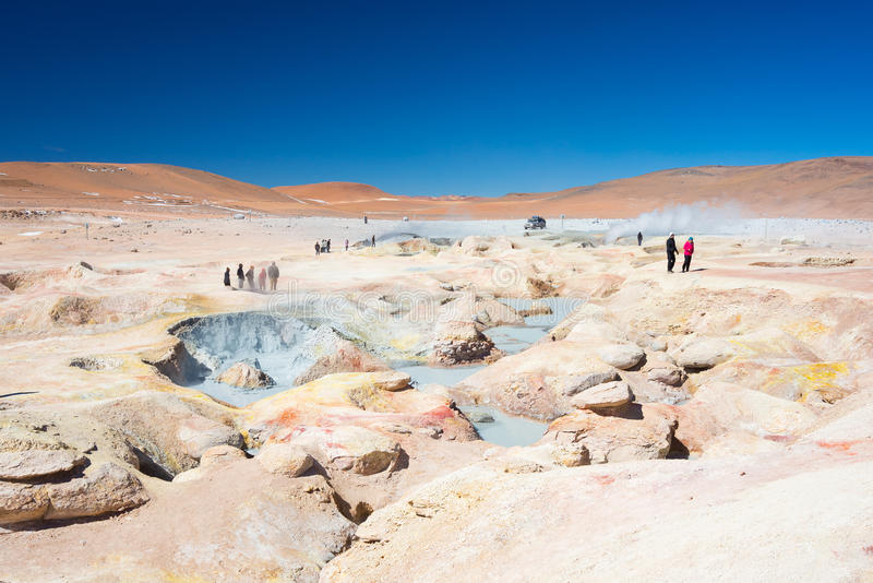 Tourism at steaming hot water ponds on the Andes, Bolivia stock photos