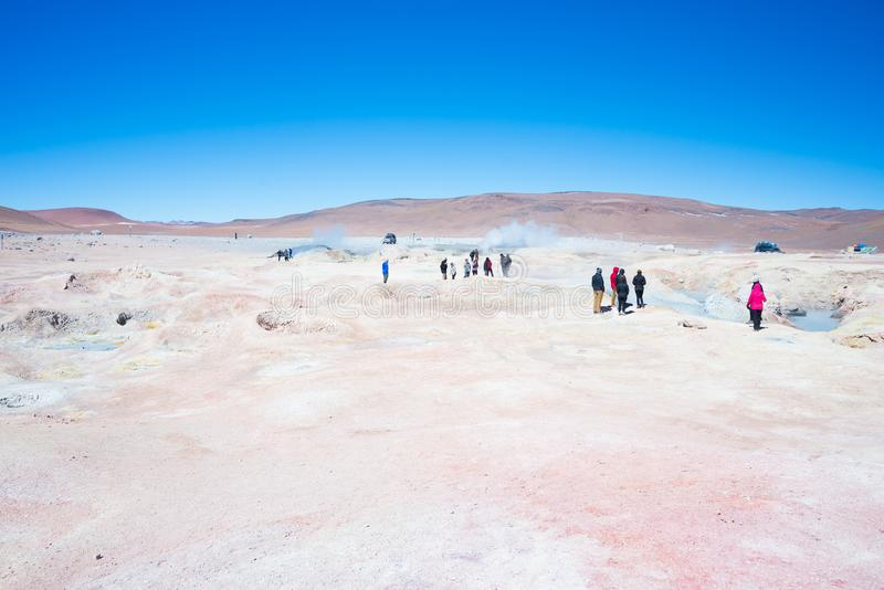 Tourism at steaming hot water ponds on the Andes, Bolivia royalty free stock images