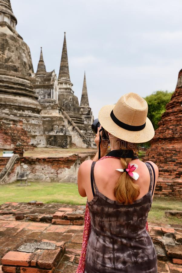 Thailand, Historic City of Ayutthaya. Tourist on the ancient runis in  Ayutthaya old city, Thailand, brigde, sitting, woman, people, mahathat, ayuthaya, worship stock image