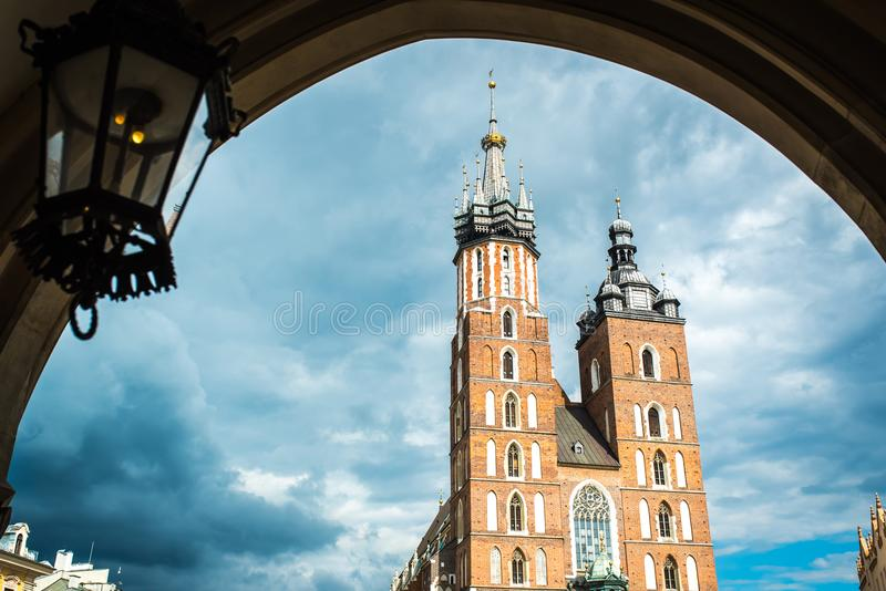 Tourist architectural attractions in the historical square of Kr. Tourist architectural attractions in the market square of Krakow stock photo
