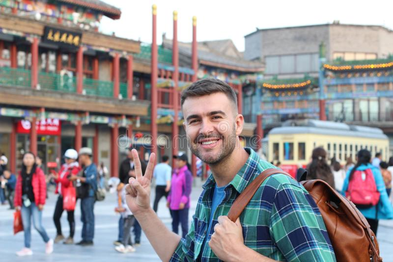 Tourist in Asia showing peace sign.  stock photos