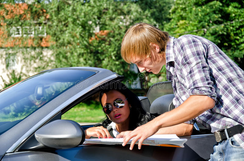 Tourist asking driver about direction. Male tourist asking female driver about direction royalty free stock images