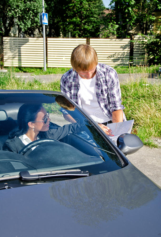 Download Tourist Asking Female Driver About Direction Stock Photo - Image: 26242742