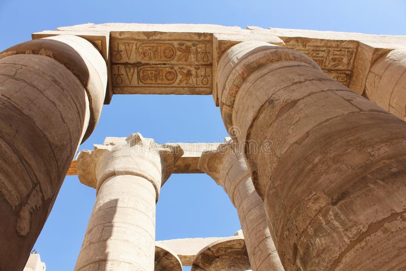 Tourist attraction – Egyptian Temple Complex Karnak. Unesco world heritage – in Egypt. Ancient Egypt images and hieroglyphics on wall in Karnak royalty free stock photo