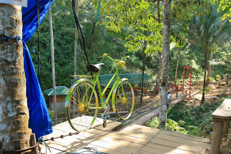 Sky Cycling, Trenggalek, East Java, Indonesia. Tourist attraction at Banyu Nget in Trenggalek, East Java, Indonesia. Bicycle over zipline across the river. Banyu stock image