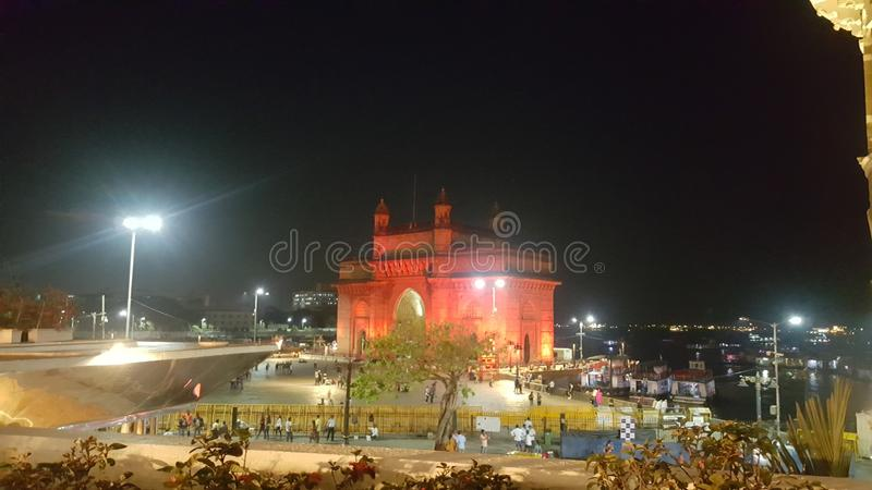 Long shot of Gateway of India at night stock photos