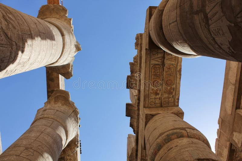 Tourist attraction. Egyptian Temple Complex Karnak. Unesco world heritage in Egypt. Ancient Egypt images and hieroglyphics on wall in Karnak Temple. Egyptian royalty free stock photo