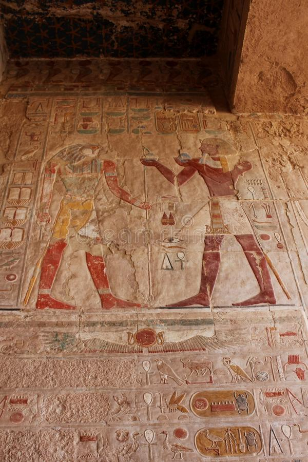 Tourist attraction. Egyptian Temple Hatsepsut – relief. Unesco world heritage. In Egypt. Ancient Egypt images and hieroglyphics on wall in Karnak Temple stock photo