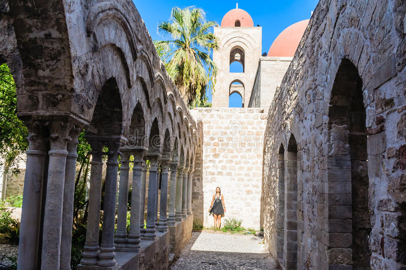 Tourist on background of cloister of the arab-norman church 'San Giovanni degli Eremiti' in Palermo. Sicily. Italy stock image