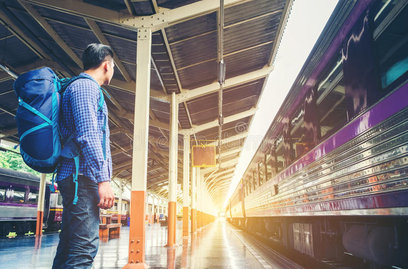 Tourist backpacker wait to travel at train station royalty free stock image