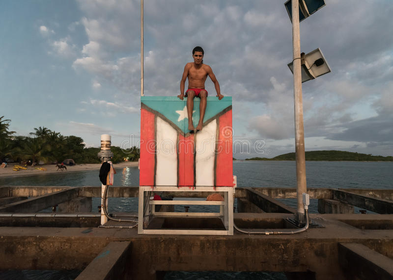 Download Tourist At The Beach Sitting On Flag In Vieques Puerto Rico Editorial Image