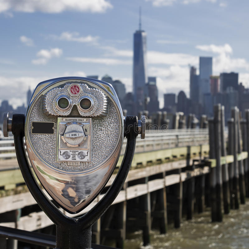 Tourist binoculars at Liberty Island. In front of Manhattan Skyline royalty free stock image