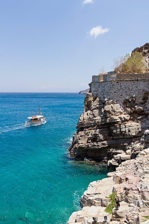 Tourist boat approaching Spinalonga Island stock images