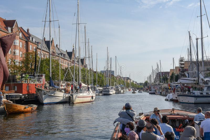 Tourist boat on a canal at Copenhagen in Denmark stock photo