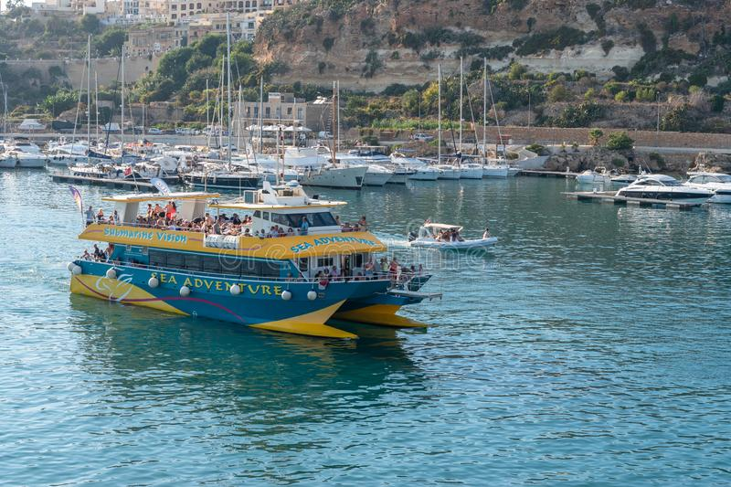 Tourist boat exiting Mgarr Harbor Gozo stock images