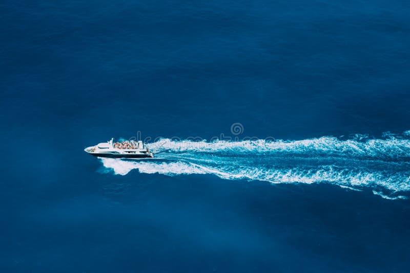Tourist boat in full speed in open sea, Greece.  stock photo